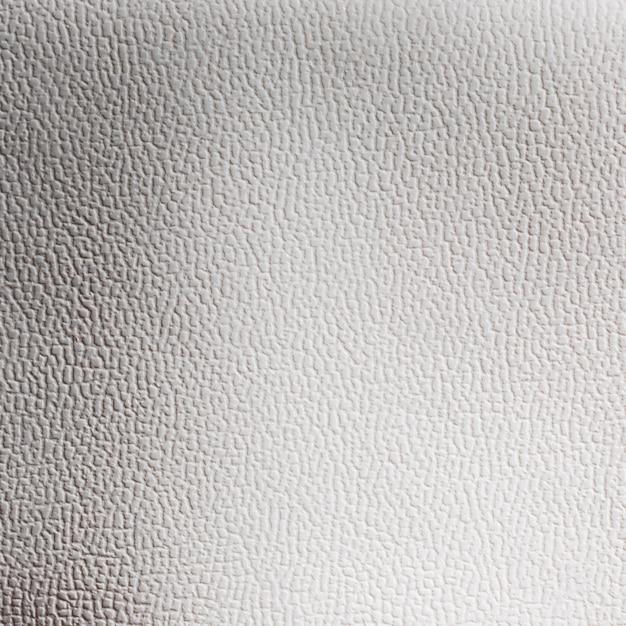 Superfície de fundo com textura de couro cinza claro extremamente close-up Foto gratuita
