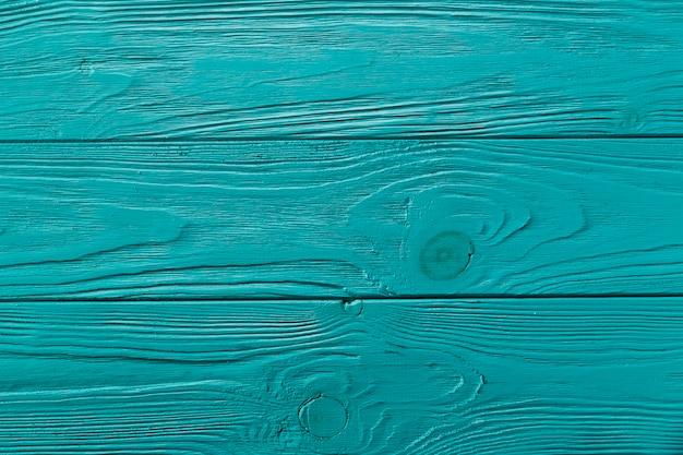 Superfície de madeira pintada de azul com nodos Foto gratuita