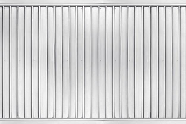 Superfície de textura de metal ondulado tira do fundo da parede do edifício industrial Foto Premium