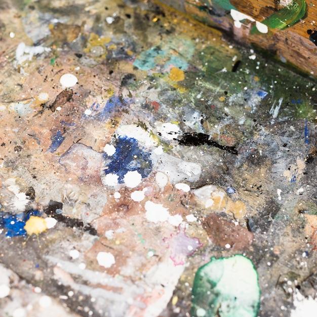 Superfície pintada aquarela abstrata texturizada suja Foto gratuita