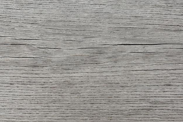 Superfície unpolished velha de madeira cinzenta do fundo com fibras horizontais. Foto Premium