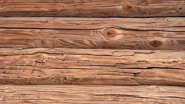 Tábuas de madeira velhas, a superfície da velha mesa em uma casa de campo. plano de fundo ou textura. Foto Premium