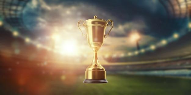 Taça de ouro no fundo do estádio Foto Premium