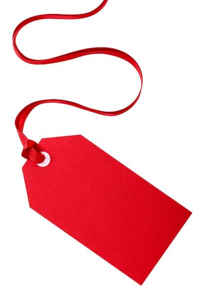 Tag do presente de natal vermelho com fita vermelha Foto gratuita