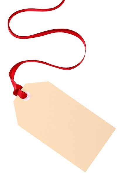 Tag do presente simples com fita vermelha isolada no fundo branco Foto gratuita