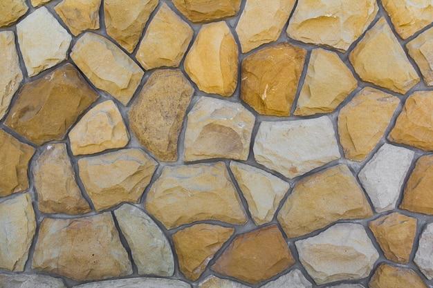 Tamanhos diferentes de pedras de areia. padrão de parede de pedra Foto Premium
