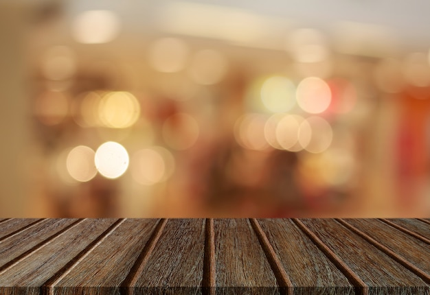 Tampo da mesa de madeira de perspectiva vazia com luz de fundo abstrato bokeh Foto Premium