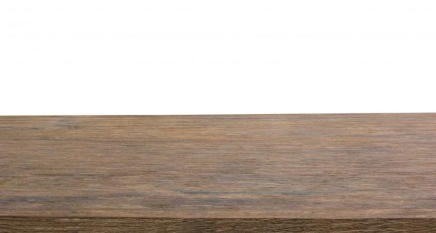 Tampo da mesa de madeira escura vazio isolado no fundo branco com traçado de recorte e copyspace para exibição ou montagem de seus produtos Foto Premium