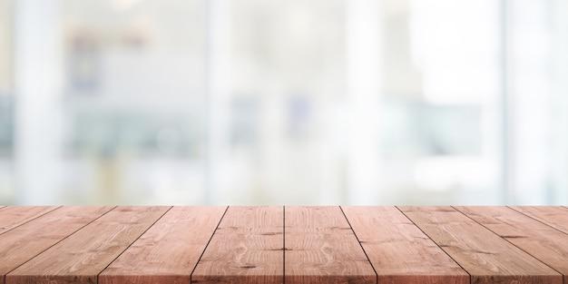 Tampo de madeira vazio e fundo abstrato do restaurante abstrato turva Foto Premium