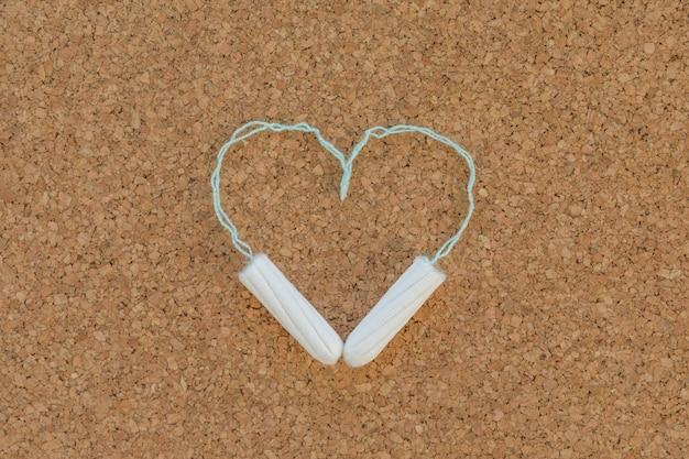 Tampões fazendo um coração Foto gratuita