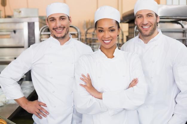 Team of bakers smiling at camera Foto Premium
