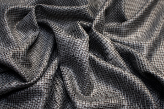 Tecido de lã com seda e pé de ganso a cor é cinza-marrom textura de fundo Foto Premium