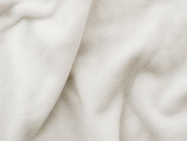Tecido dobrado branco de tecido texturizado Foto gratuita
