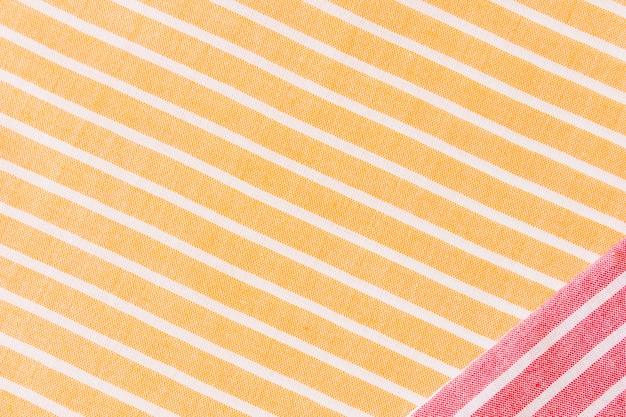 Tecido vermelho em amarelo e branco listras toalha de mesa têxtil Foto gratuita