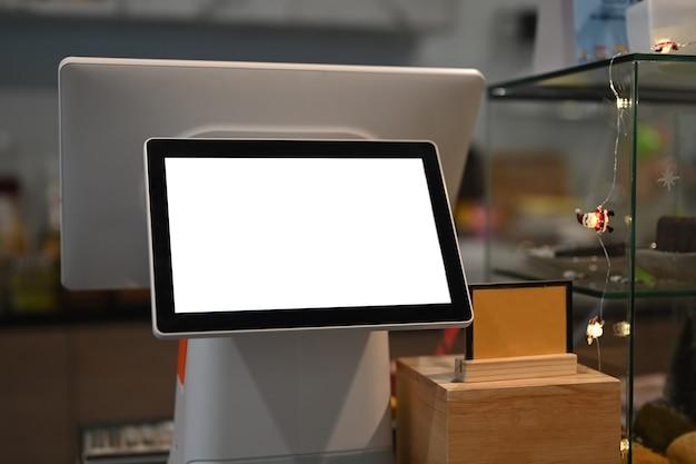 Tela de toque da máquina de caixa com tela em branco no café moderno. Foto Premium