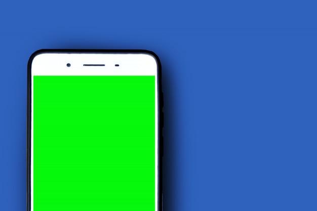 Tela verde de smartphone em azul Foto Premium