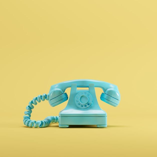 Telefone azul do vintage no fundo amarelo da cor pastel. conceito de ideia mínima. Foto Premium