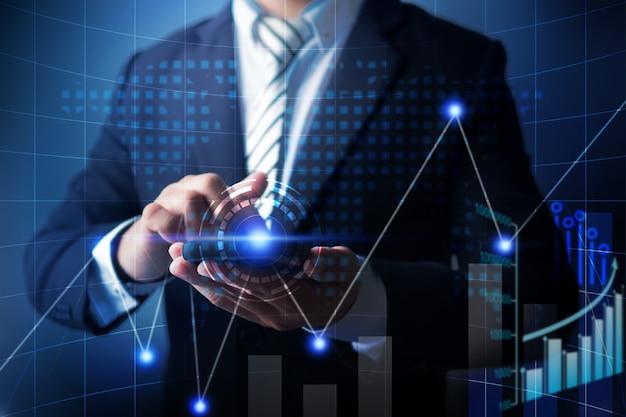 Telefone celular do uso do homem de negócios a analisar dados do negócio da finança com carta digital econômica do gráfico. Foto Premium