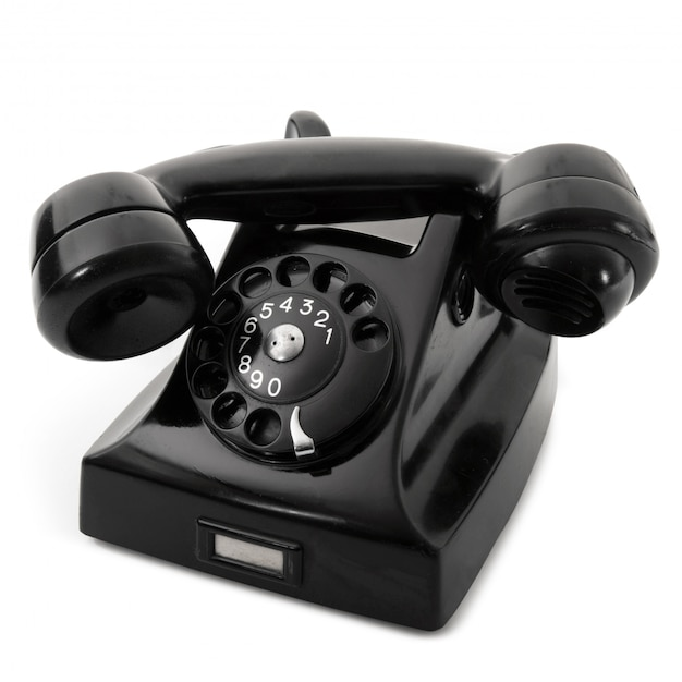 Telefone obsoleto no preto Foto Premium