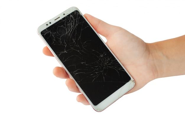 Telefone quebrado branco na mão masculina Foto Premium