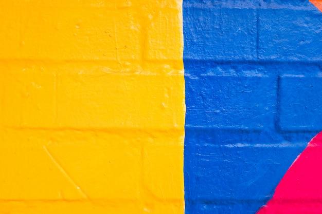 Teste padrão colorido pintado em uma parede. Foto Premium