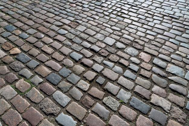 Teste padrão da pedra alemão antiga na cidade no centro. Foto Premium