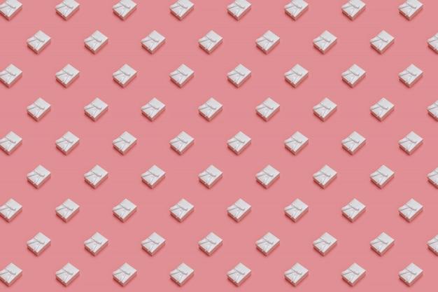 Teste padrão feito das caixas de presente brancas no fundo do rosa pastel. presentes em isométrico Foto Premium