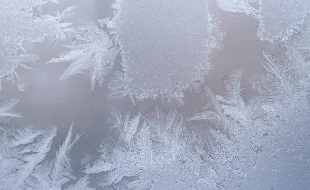 Teste padrão gelado no vidro de janela do inverno. Foto Premium