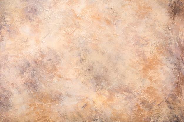 Textura arenosa concreta alaranjada do fundo da pedra. horizontal. Foto Premium