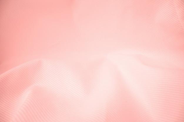 Textura brilhante de pano fluindo no tiro macro. Foto Premium