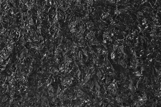 Textura cinzenta preta brilhante do metal da folha, papel de envolvimento abstrato com alta resolução para o fundo. Foto Premium