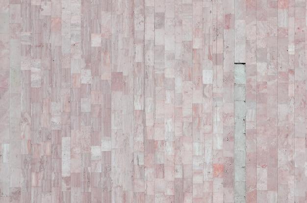 Textura da parede de mármore bege antiga feita a partir de uma variedade de azulejos grandes Foto Premium