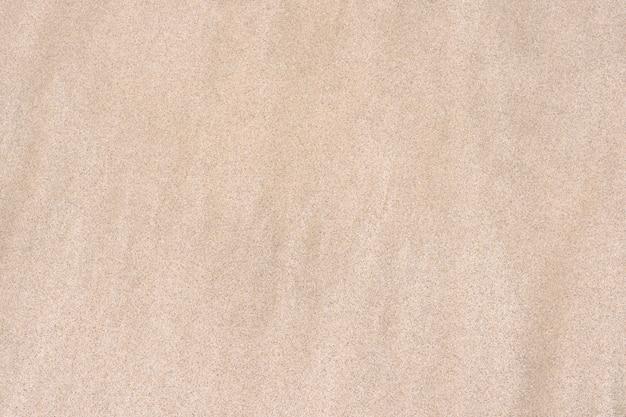Textura de areia. praia de areia para o fundo. Foto Premium