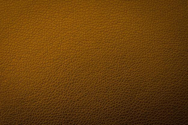 Textura de couro de ouro para o fundo, resumo do sofá Foto Premium