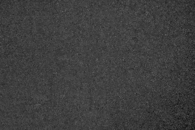 Textura de estrada de asfalto na cor cinza escuro Foto gratuita