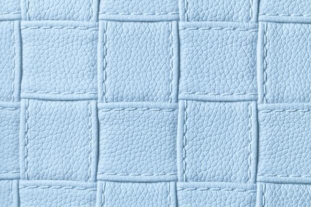 Textura de fundo de couro azul claro com padrão de quadrados e pontos, macro. Foto Premium
