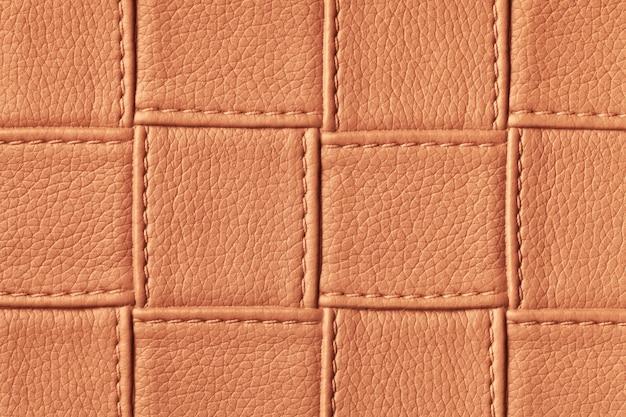Textura de fundo de couro laranja escuro e vermelho com padrão de quadrados e pontos Foto Premium