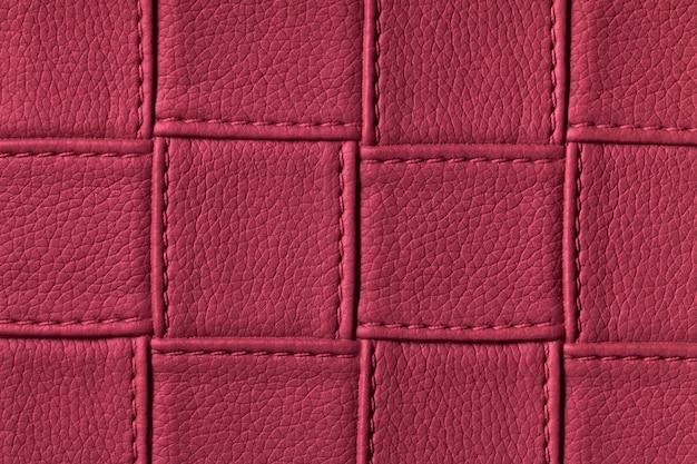 Textura de fundo de couro roxo escuro com padrão de quadrados e pontos. Foto Premium