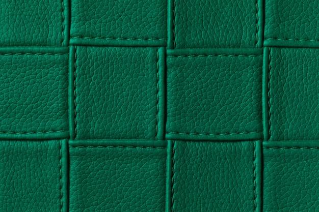 Textura de fundo de couro verde escuro com padrão de quadrados e pontos. Foto Premium