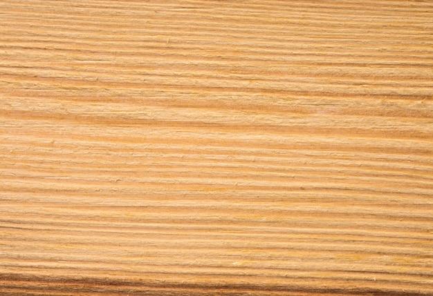 Textura de madeira de tronco de árvore cortado, fundo close-up Foto Premium