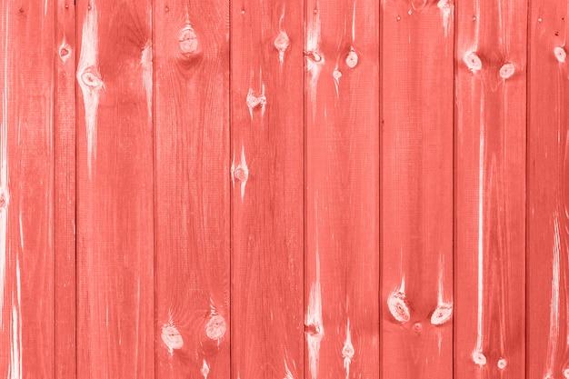Textura de madeira em tons de cor coral viva Foto Premium