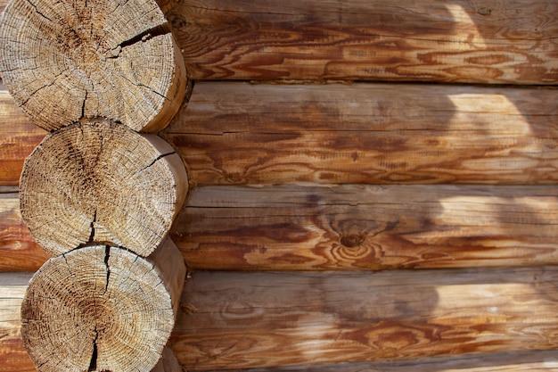 Textura de madeira, log cabana de toras, um abate, o lugar para uma inscrição, espaço para texto, copyspace Foto Premium