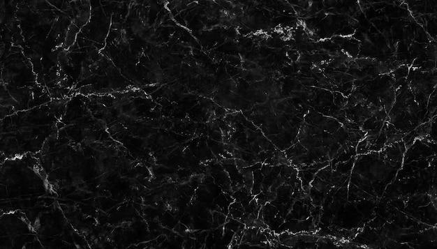 Textura de mármore preto natural para papel de parede de azulejo de pele fundo luxuoso Foto Premium