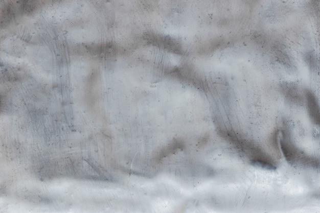 Textura de metal amassado, fundo de aço inoxidável com danos mecânicos Foto Premium