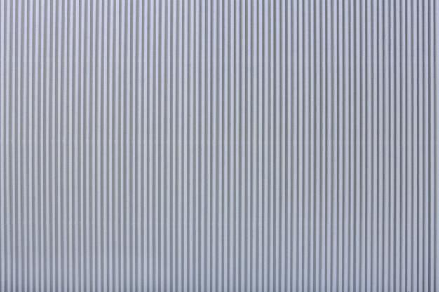 Textura de papel cinza claro ondulado, macro Foto Premium