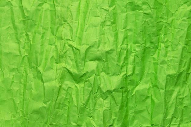 Textura de papel verde amassado, fundo grunge Foto Premium