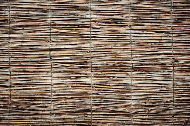 Textura de parede de cana. fundo de vedação tradicional Foto Premium