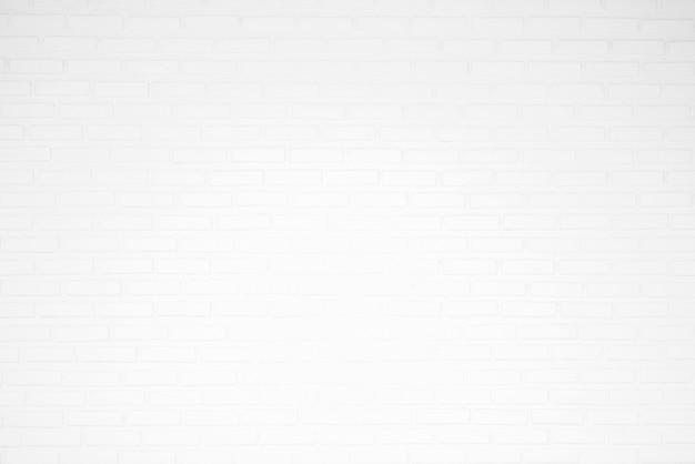 Textura de parede de tijolo branco para fundos Foto Premium
