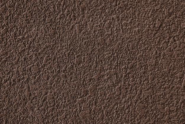 Textura de parede rebocada de cimento marrom áspero Foto gratuita