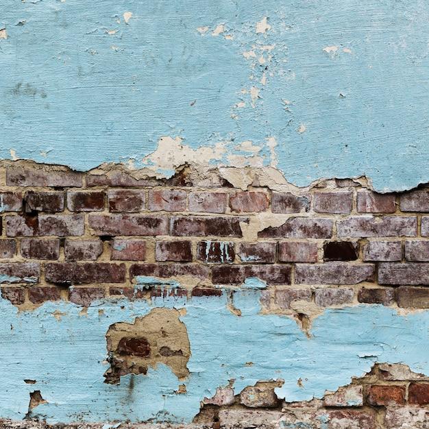 Textura de paredes de tijolo pintado descascado Foto gratuita